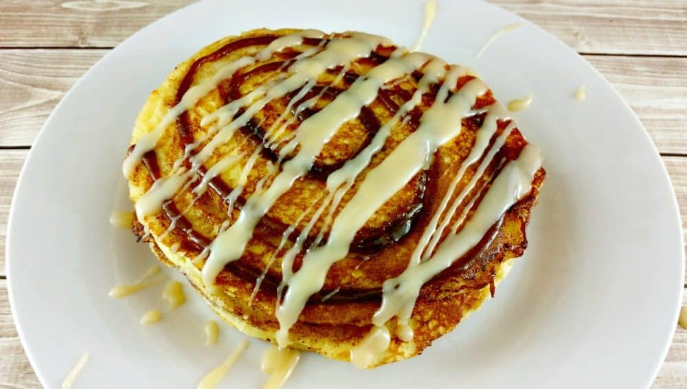 Sometimes? You want something more for breakfast and these? Oh my soul! These cinnamon roll pancakes combine the best of your favorite cinnamon roll recipe with a delicious buttermilk pancake! Warm, gooey and melt in your mouth, your breakfast will never be the same again!
