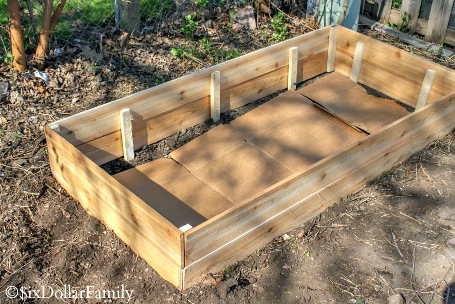 Once Your DIY Raised Garden Bed Is Assembled, Carry It To Wherever Youu0027re  Placing It In Your Yard. If Your Supports Were Longer Than The Boards, ...