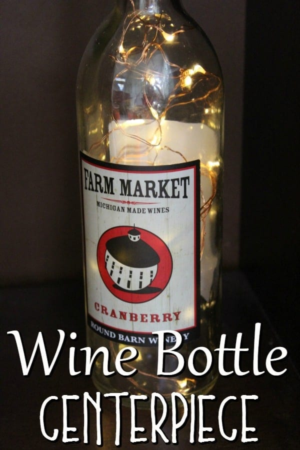 Do you love upcycling? If so, you'll love this upcycled craft idea! This wine bottle centerpiece is the perfect wine bottle craft for any time of the year!