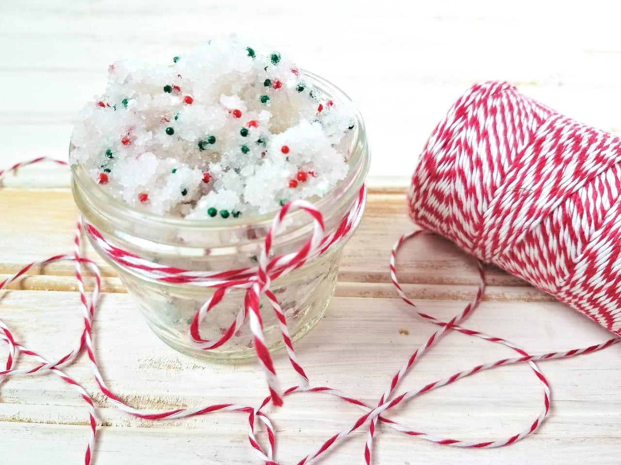 Bring your favorite Christmas sugar cookie into your beauty routine with this super simple sugar scrub recipe. You'll love the amazing scent of baking Christmas cookies while leaving your skin super soft at the same time!