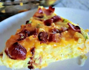 Bacon eggs and cheese tempt your taste buds in this freezer friendly, super simple and budget friendly breakfast casserole recipe. Even the pickiest eaters will love it!